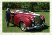 1957 Bentley S1 convertible in Burgundy with Cream leather interior and Burgundy piping.