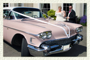 1958 Pink Cadillac with White roof