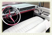 Iconic 1959 Pink Cadillac convertible with White roof