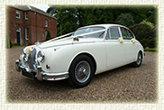 1961 MK II Jaguar in Old English White with spoked wheels