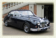 1967 Daimler (with MK II body) in Navy Blue with chrome wire wheels and light Blue leather interior