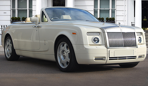 Rolls Royce Phantom Limousine drop-head convertible in Corniche White with Cream leather interior and private plates