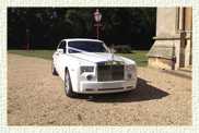 Modern Rolls Royce Phantom in Pearlescent White with light biscuit leather interior