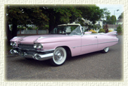 1959 Pink Cadillac convertible<br>                   (with electronically retractable white roof)